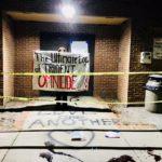 banner behind crime scene