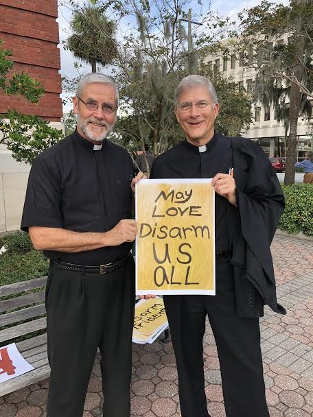 Father Bob Cushing and Bishop Joseph Kopacz outside of the Federal court in Brunswick, GA.